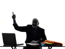 Homem de negócio superior que aponta acima da silhueta Fotografia de Stock