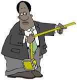 Homem de negócios étnico que usa uma grande fita métrica Foto de Stock