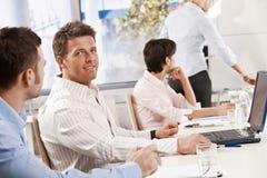 homem de negócios 40s na reunião de negócio Imagem de Stock Royalty Free