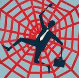 Homem de negócios abstrato travado em uma Web de aranhas. Fotografia de Stock Royalty Free
