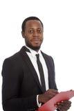Homem de negócios africano de sorriso com uma prancheta Imagem de Stock