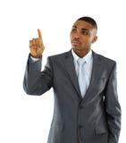 Homem de negócios africano isolado em apontar branco Fotos de Stock Royalty Free