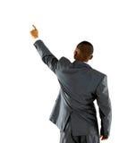 Homem de negócios africano que aponta na parede Imagens de Stock Royalty Free
