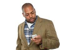 Homem de negócios afro-americano Using Cellphone fotografia de stock royalty free