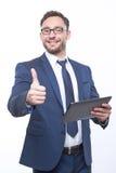 Homem de negócios agradável que guarda o portátil Imagens de Stock Royalty Free