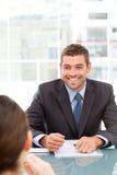 Homem de negócios alegre durante uma reunião Imagens de Stock Royalty Free