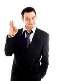 Homem de negócios amigável que mostra o sinal aprovado Imagens de Stock