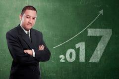 Homem de negócios asiático atrativo com número 2017 Imagens de Stock