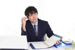 Homem de negócios asiático inquieto imagens de stock