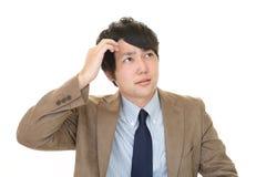 Homem de negócios asiático inquieto imagem de stock royalty free