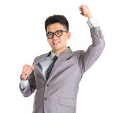 Homem de negócios asiático que comemora o sucesso Imagens de Stock Royalty Free