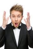 Homem de negócios assustado e gritando com mãos acima fotografia de stock