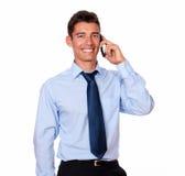 Homem de negócios atrativo que fala em seu telefone fotos de stock royalty free