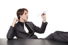 Homem de negócios - avião de papel furado Foto de Stock