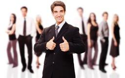 Homem de negócios bem sucedido com sua equipe fotografia de stock royalty free