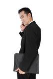 Homem de negócios bem sucedido ereto no telefone, isolado no branco fotografia de stock royalty free