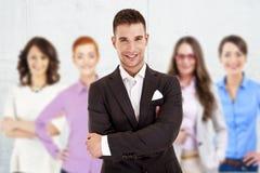 Homem de negócios bem sucedido que conduz um grupo Fotos de Stock Royalty Free