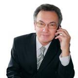Homem de negócios bem sucedido que fala no handphone Imagem de Stock Royalty Free