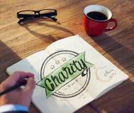 Homem de negócios Brainstorming About Charity e trabalho do relevo fotografia de stock