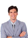 Homem de negócios carismático com braços dobrados Fotografia de Stock Royalty Free