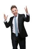 Homem de negócios carismático nos vidros com mãos acima imagem de stock royalty free