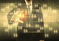 Homem de negócios Choosing a pessoa adequada Fotografia de Stock Royalty Free
