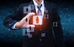 Homem de negócios Choosing a pessoa adequada Imagem de Stock