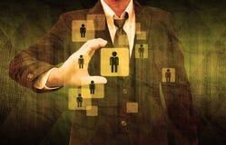 Homem de negócios Choosing a pessoa adequada no papel velho Imagem de Stock