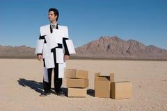 Homem de negócios coberto com os papéis imagem de stock royalty free