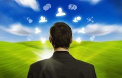 Homem de negócios com ícones sociais da rede Fotos de Stock