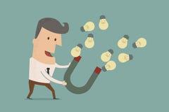Homem de negócios com ímã em ferradura que recolhe a ampola Imagem de Stock