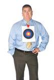 Homem de negócios com alvo do olho de touros na camisa imagem de stock