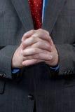 Homem de negócios com as mãos clasped foto de stock royalty free