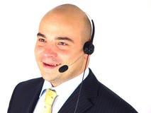 Homem de negócios com auriculares Imagens de Stock Royalty Free