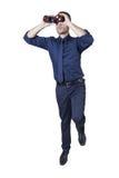 Homem de negócios com binóculos em uma escada foto de stock royalty free