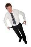 Homem de negócios com bolsos vazios fotografia de stock royalty free