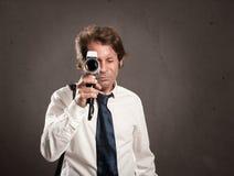 Homem de negócios com a câmera retro do filme fotos de stock royalty free