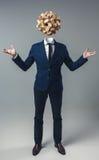 Homem de negócios com a caixa do cubo do jogo em vez da cabeça Imagem de Stock Royalty Free