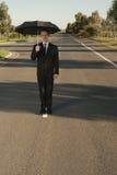 Homem de negócios com cara do guarda-chuva Imagem de Stock