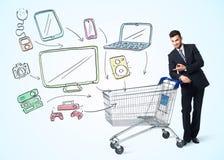 Homem de negócios com carrinho de compras Imagem de Stock Royalty Free