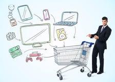 Homem de negócios com carrinho de compras Fotos de Stock Royalty Free