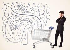 Homem de negócios com carrinho de compras Fotos de Stock