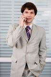 Homem de negócios com celular fotografia de stock