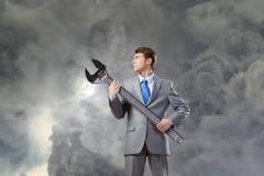 Homem de negócios com chave Fotografia de Stock