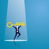 Homem de negócios com chave do sucesso Fotografia de Stock Royalty Free