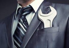 Homem de negócios com chave inglesa imagens de stock