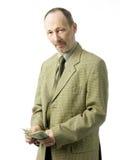 Homem de negócios com dólares Imagens de Stock Royalty Free