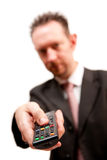 Homem de negócios com de controle remoto Imagem de Stock