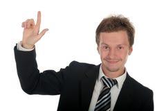 Homem de negócios com dedo que aponta acima Fotos de Stock Royalty Free
