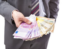 Homem de negócios com dinheiro à disposição Imagem de Stock Royalty Free